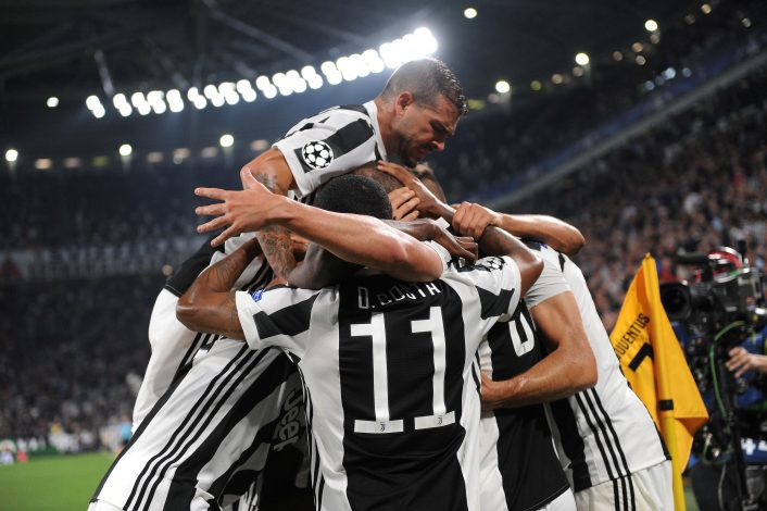 Juventus' Gonzalo Higuain celebrates with team mates after scoring their second goal.