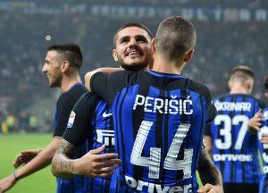 Inter Milan's Mauro Icardi celebrates scoring their first goal with Ivan Perisic.