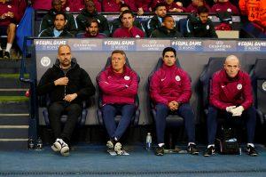 Pep Guardiola and coach Mikel Arteta (2nd R).