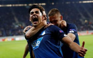 Hoffenheim's Nadiem Amiri celebrates scoring their second goal with teammates.