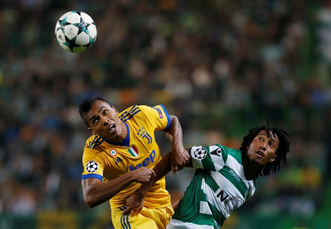 Juventus' Alex Sandro in action with Sporting's Gelson Martins.