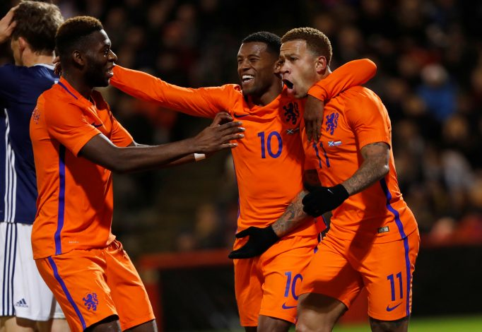 Netherlands' Memphis Depay celebrates scoring their first goal with Georginio Wijnaldum and Timothy Fosu-Mensah (L).