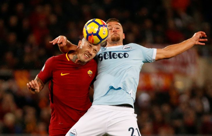 Roma's Radja Nainggolan in action with Lazio's Sergej Milinkovic-Savic.