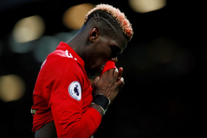 Manchester United's Paul Pogba walks off at half time.