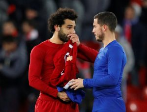 Liverpool's Mohamed Salah speaks with Chelsea's Eden Hazard.