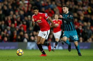Manchester United's Marcus Rashford in action with Southampton's Sam McQueen.