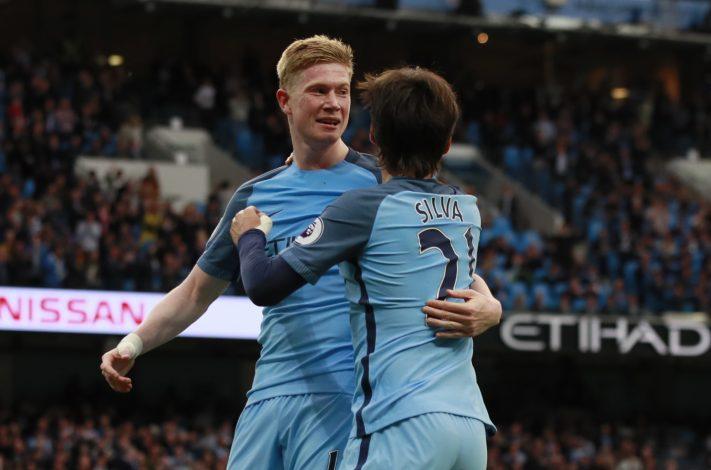 Man City's Kevin De Bruyne celebrates scoring their second goal with David Silva.