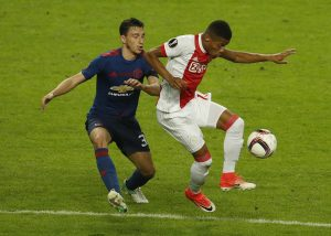 Ajax's David Neres in action with Matteo Darmian.