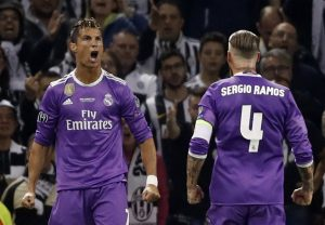 Cristiano Ronaldo celebrates scoring with Sergio Ramos.