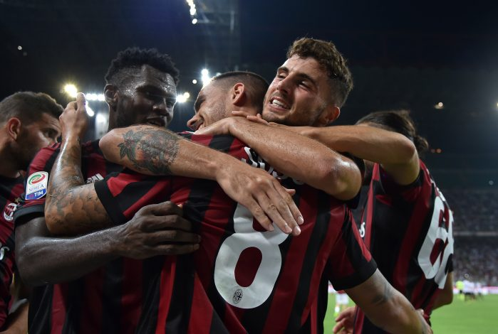 AC Milan's Suso celebrates scoring their second goal with teammates.
