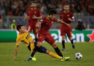 AS Roma's Diego Perotti in action with Atletico Madrid's Nicolas Gaitan.