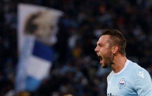 Lazio's Stefan de Vrij celebrates scoring their first goal.