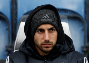 Henrikh Mkhitaryan sat on the bench before the match.