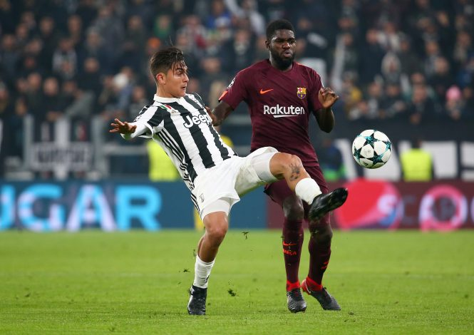 Juventus' Paulo Dybala in action with Barcelona's Samuel Umtiti.