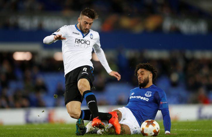 Everton's Ashley Williams fouls Atalanta's Bryan Cristante for a penalty.