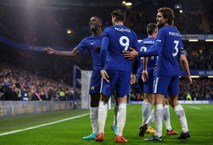 Antonio Rudiger celebrates scoring their first goal with Marcos Alonso, Alvaro Morata and team mates.