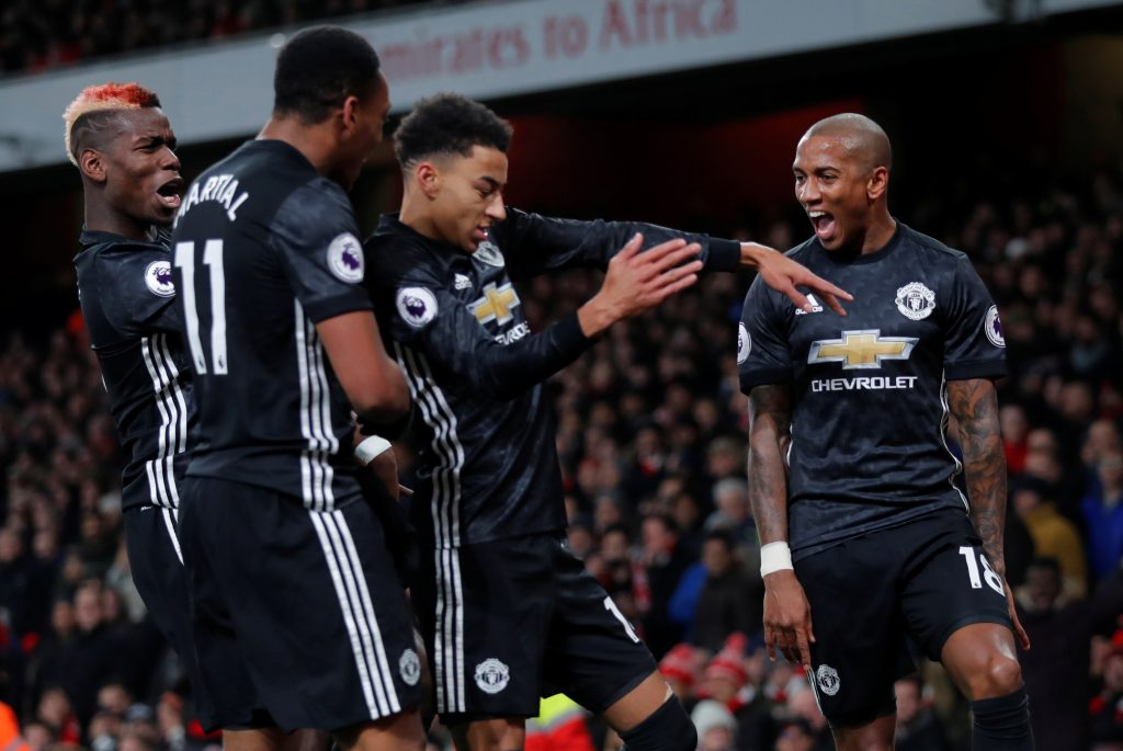 Jesse Lingard celebrates with team mates.