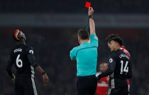 Paul Pogba is shown a red card by referee Andre Marriner.