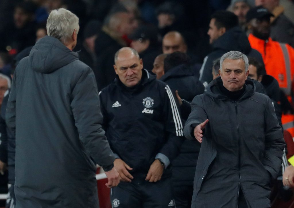Jose Mourinho gestures to shake hands with Arsene Wenger after the match.