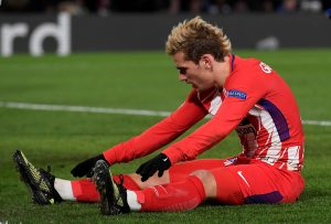 Atletico Madrid's Antoine Griezmann looks dejected.
