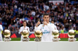 Real Madrid's Cristiano Ronaldo with his five Ballon d'Or trophies before the match.