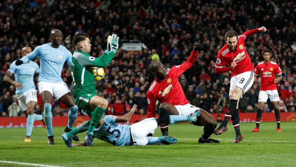 Juan Mata has a shot saved by Man City's Ederson.
