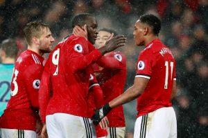 Manchester United's Romelu Lukaku celebrates scoring their first goal with team mates.