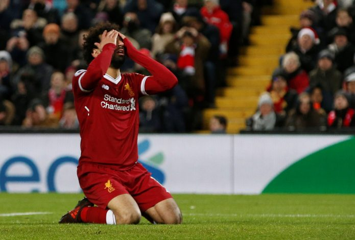 Liverpool's Mohamed Salah reacts after missing a header.