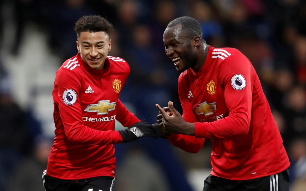 Manchester United's Jesse Lingard celebrates scoring their second goal with Romelu Lukaku.