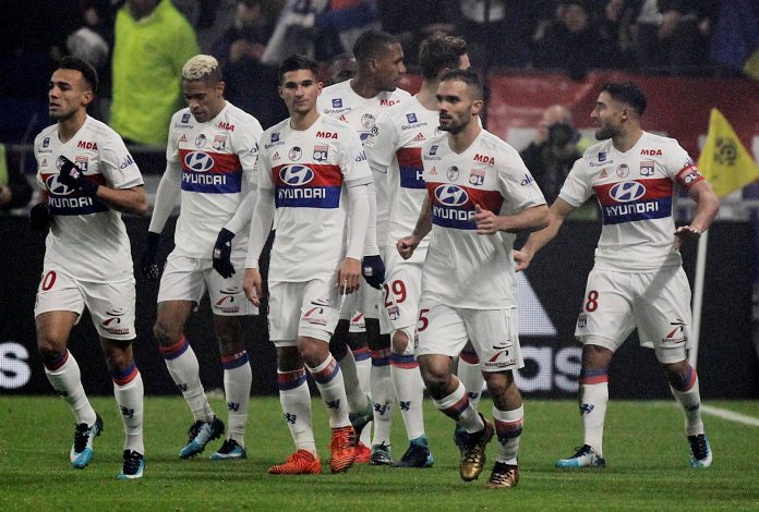 Lyon's Nabil Fekir celebrates scoring their first goal with team mates.