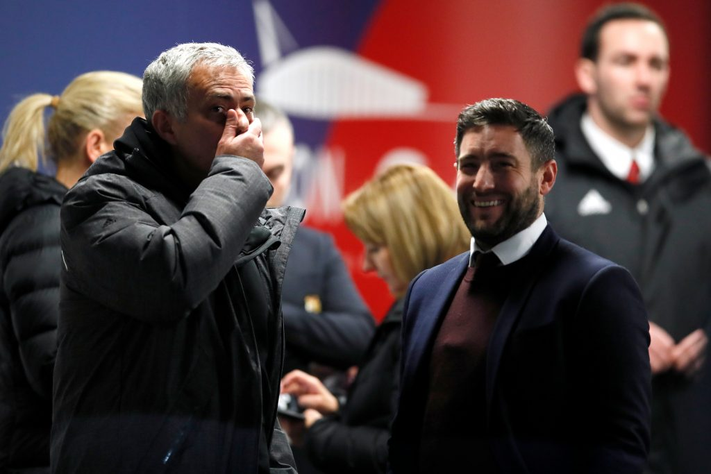 Jose Mourinho speaks with Bristol City manager Lee Johnson.