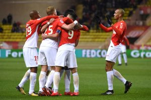 Monaco's Radamel Falcao celebrates scoring their first goal with team mates.