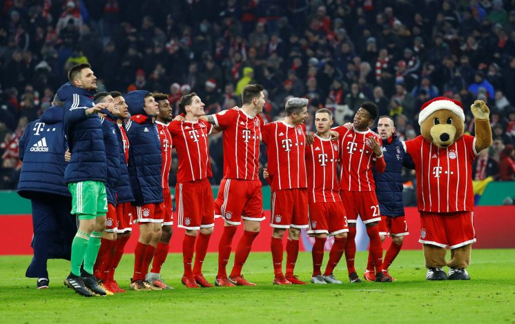 Bayern Munich players line up in celebration after the match.