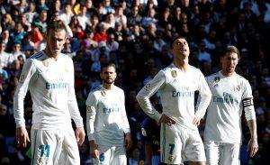 Real Madrid's Gareth Bale, Cristiano Ronaldo and Sergio Ramos react.