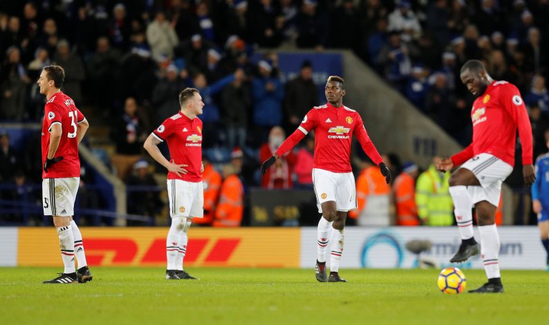 Paul Pogba and team mates look dejected.
