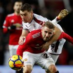 Burnley's Sam Vokes in action with Luke Shaw.