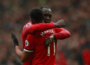 Anthony Martial celebrates scoring with Romelu Lukaku.