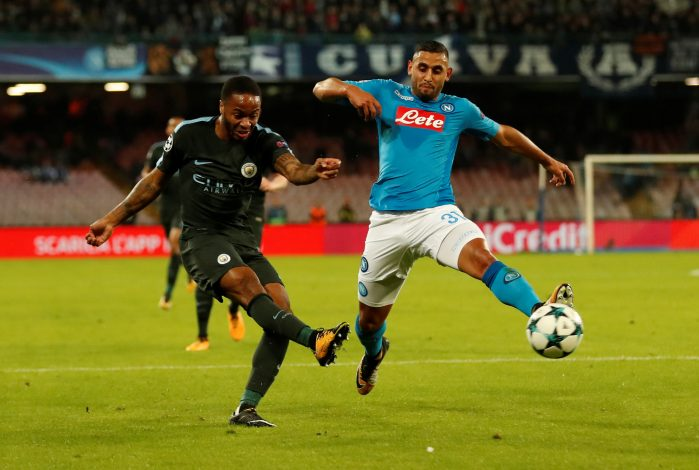Man City's Raheem Sterling in action with Napoli's Faouzi Ghoulam.
