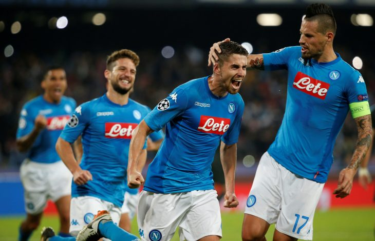 Napoli's Jorginho celebrates scoring their second goal with Marek Hamsik (R) and team mates.