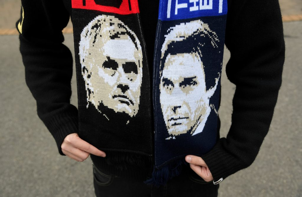 Antonio Conte and Jose Mourinho on a scarf worn by a fan outside the stadium before the match.