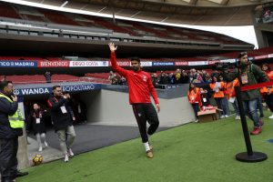 Atletico Madrid's soccer player Diego Costa waves to fans.