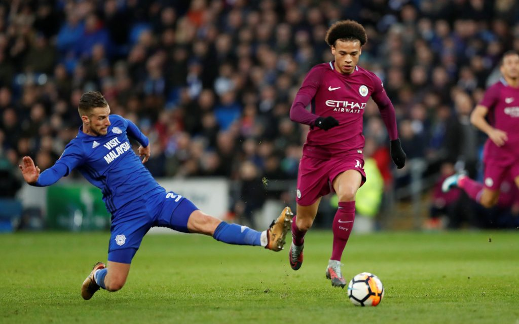 Man City's Leroy Sane is fouled by Cardiff City's Joe Bennett.