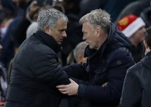 Jose Mourinho and David Moyes shake hands after the game.