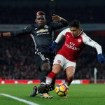 Manchester United's Paul Pogba in action with Alexis Sanchez.