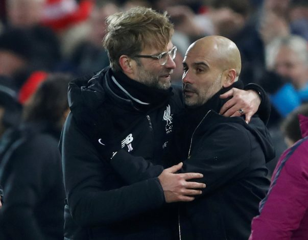 Jurgen Klopp shakes hands with Pep Guardiola after the match.