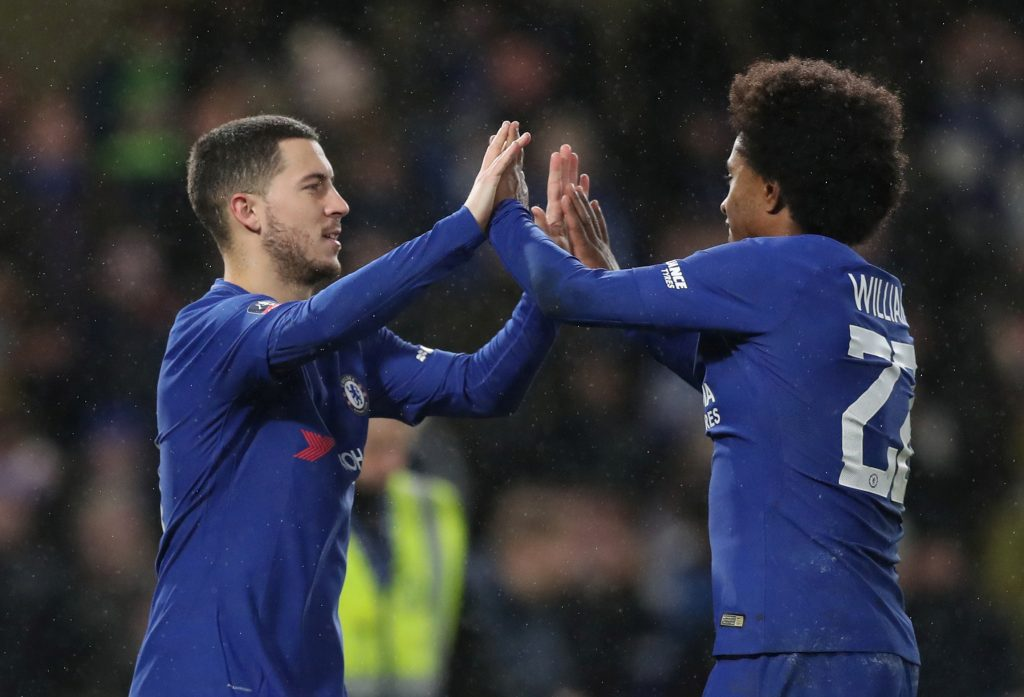 Chelsea's Eden Hazard celebrates with Willian after winning the penalty shoot out.