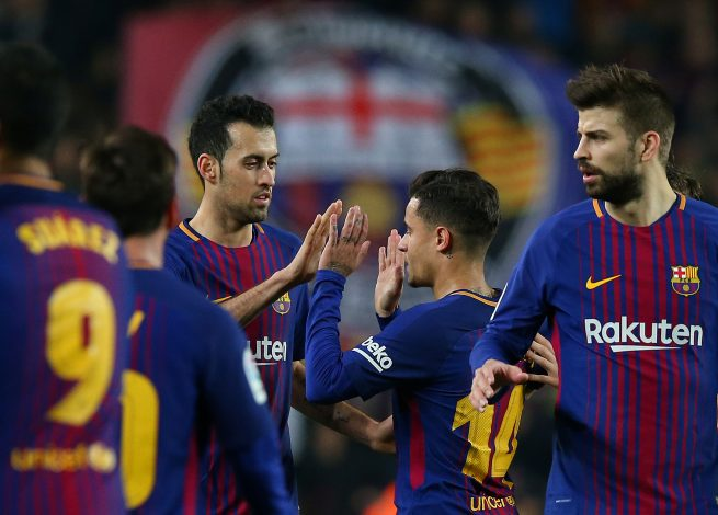 Barcelona's Philippe Coutinho celebrates after the match with Sergio Busquets.