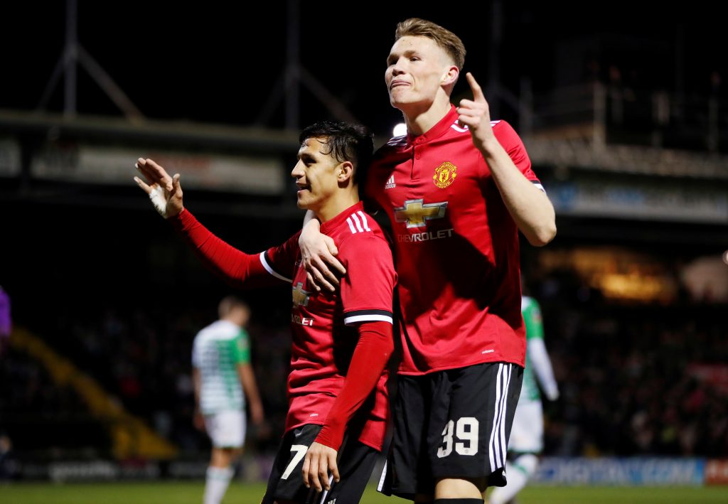 Manchester United's Alexis Sanchez celebrates their second goal with Scott McTominay.