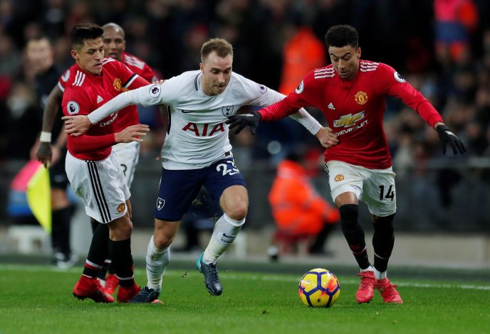 Tottenham's Christian Eriksen in action with Alexis Sanchez and Jesse Lingard.