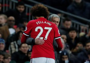 Marouane Fellaini gets a hug from manager Jose Mourinho as he is substituted shortly after coming on.